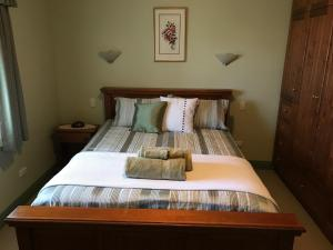 A bed or beds in a room at Girraween House