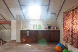 A kitchen or kitchenette at Vacation home in Sosnovy bor