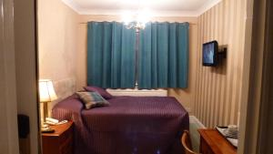 A bed or beds in a room at Beech House Hotel