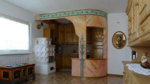 Cucina o angolo cottura di La Capinera Canazei