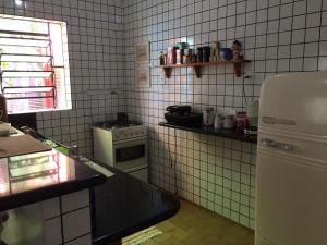 A kitchen or kitchenette at Hospedaria Frei Caneca