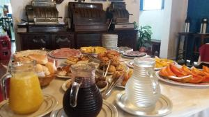 Breakfast options available to guests at Pousada Santa Rita