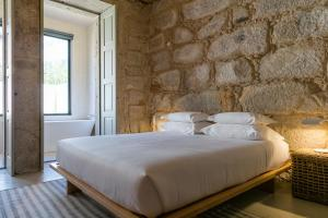A bed or beds in a room at Armazém Luxury Housing- Architectural & Design Hotel