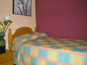 Cama o camas de una habitación en Hotel Paris Centro