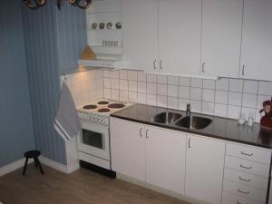 A kitchen or kitchenette at Värdshuset Lugnet