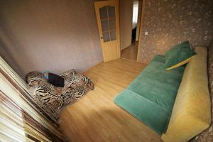 A bed or beds in a room at Apartments at Krylova 81