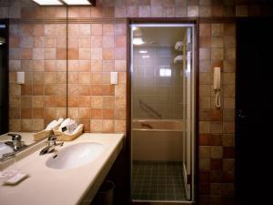 A bathroom at Yakushima Iwasaki Hotel