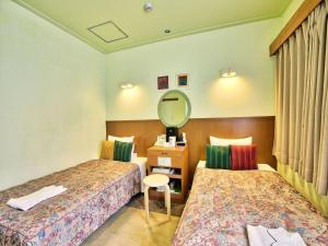 A bed or beds in a room at Sun Palace Kyuyokan