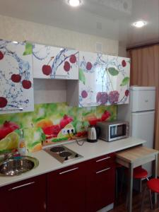 A kitchen or kitchenette at VD Apartments