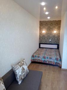 A bed or beds in a room at VD Apartments