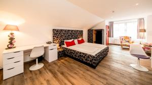 A bed or beds in a room at artHOTEL Magdeburg
