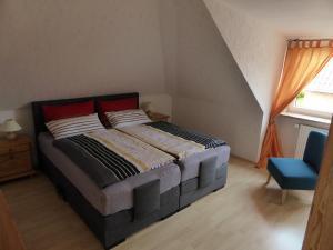 Ein Bett oder Betten in einem Zimmer der Unterkunft Ferienwohnung Haus Rita