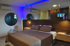 A bed or beds in a room at Kamur Plaza Hotel