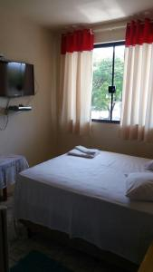 A bed or beds in a room at Hotel Nápoli