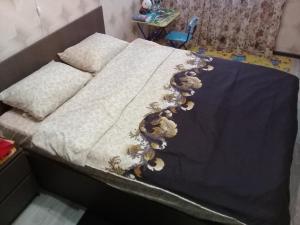 Кровать или кровати в номере Квартира на Льва Толстого