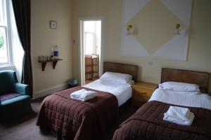 A bed or beds in a room at The Cuilfail Hotel
