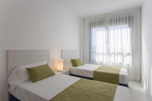 Кровать или кровати в номере Pierre & Vacances Torredembarra