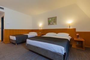 Postel nebo postele na pokoji v ubytování Hotel Grabovac