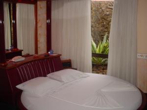 Cama ou camas em um quarto em Motel Paradise