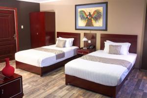 Een bed of bedden in een kamer bij Hotel Palacio