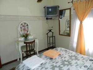 A television and/or entertainment center at Casa De Amigos