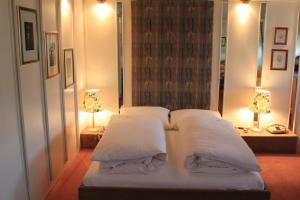 Ein Bett oder Betten in einem Zimmer der Unterkunft Hotel Spahr