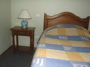 Un ou plusieurs lits dans un hébergement de l'établissement Le Soleil
