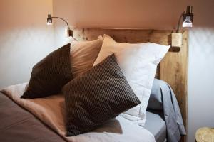Un ou plusieurs lits dans un hébergement de l'établissement La Foyère