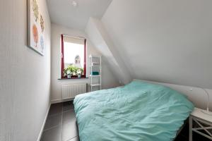 A bed or beds in a room at Vakantieappartementen centrum Oudewater