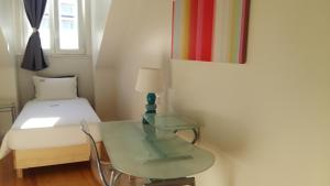 Cama o camas de una habitación en Sincerely Lisboa