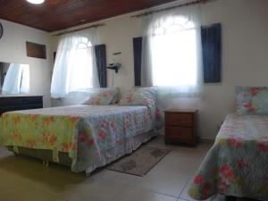 A bed or beds in a room at Casa Pontal Ilheus