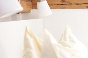 Ein Bett oder Betten in einem Zimmer der Unterkunft Pfannkuchenhaus Fehmarn