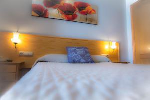 Кровать или кровати в номере L'Oncle Pere Habitacions