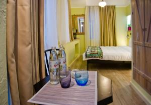 A bed or beds in a room at No12 Boutique Hotel