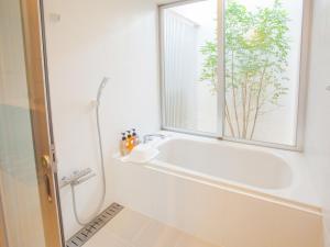かりゆしコンドミニアムリゾート恩名 真栄田ベースにあるバスルーム