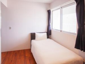 かりゆしコンドミニアムリゾート恩名 真栄田ベースにあるベッド