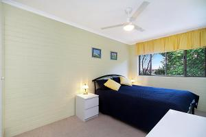 A bed or beds in a room at White Caps Unit 7 - 400 Metres to Kirra Beach