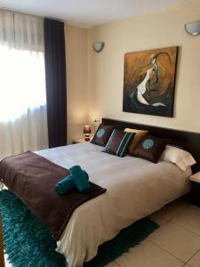 Cama o camas de una habitación en OLAS APARTMENT Holidays Torremolinos