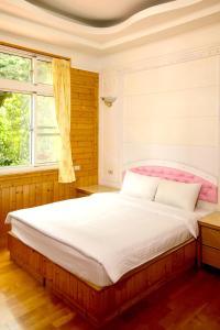 藝欣山莊 房間的床