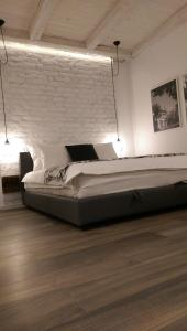 A bed or beds in a room at City Center LUX Apartment