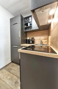 Cuisine ou kitchenette dans l'établissement Appartement Casa Monte by HolidayFlats24
