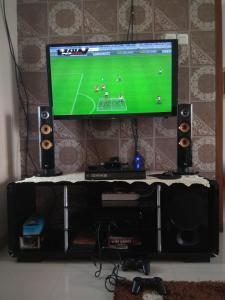 A television and/or entertainment centre at Villa Cemara, Batu