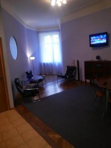 Телевизор и/или развлекательный центр в Apartment in Swedish Style