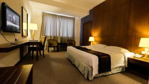 A bed or beds in a room at Times Hotel Brunei