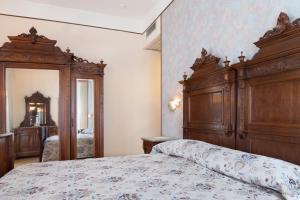 Letto o letti in una camera di Park Hotel Le Magnolie