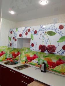 Кухня или мини-кухня в Apartment on Moskovskaya
