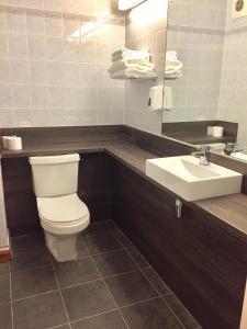 A bathroom at Days Inn Sandy