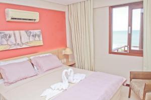 Cama ou camas em um quarto em Residence Kariri Beach Cumbuco