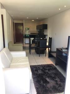 Uma área de estar em Flat Beira Mar Manaíra