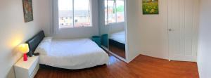 A bed or beds in a room at CDB CABRAMATTA 2 BEDROOM 3-5 PEOPLE